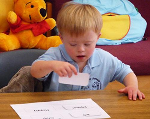 Boy matching word cards
